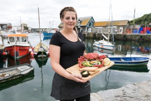 Friendly Staff Serving Seafood at the Wheelhouse Restaurant Mevagissey